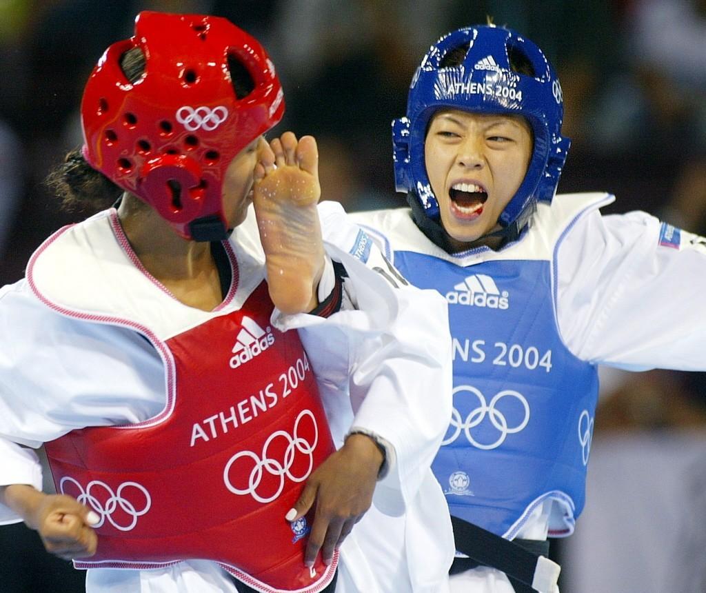 陳詩欣2004年雅典奧運為中華隊奪得首面奧運金牌,比賽中嘴角滲血。聯合報系資料照